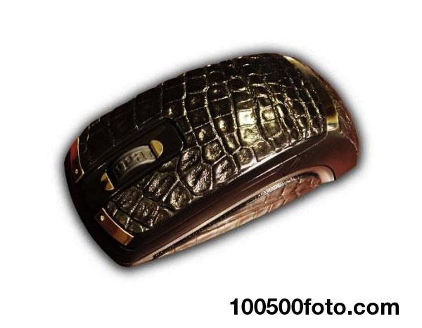 Золотистая мышь «Феррари» из кожи крокодила по цене $17 258
