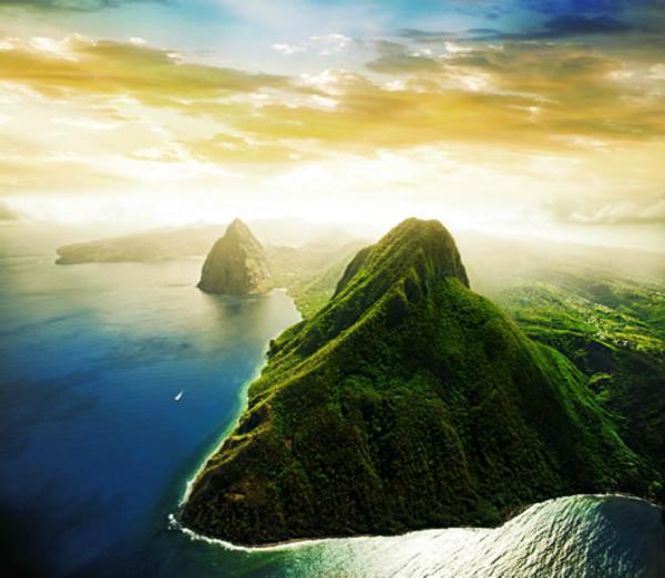 Сент-Люсия (Карибский бассейн) Остров-государство с первозданной природой. Потухшие вулканы подарили острову необыкновенные пляжи с черным песком, райские закоулки для дайвинга и роскошные горные ландшафты, напоминающие пейзажи из фантастических фильмов.